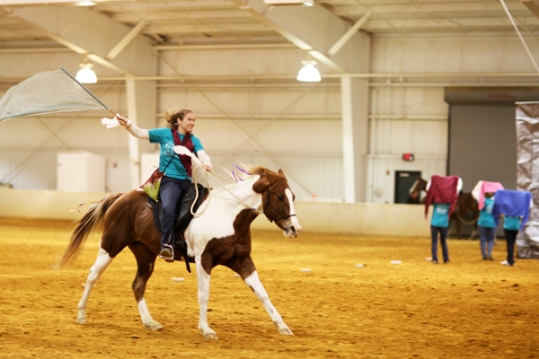 "Dramatic opening shot of our Bollywood dance routine to ""Mauja hi Mauja"" - Shannon rides across the arena! :)"